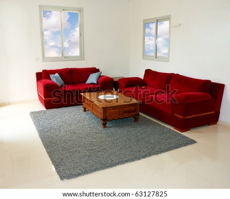View of a modern living room with red sofas
