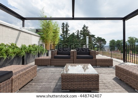 View of a modern patio with comfortable garden furniture