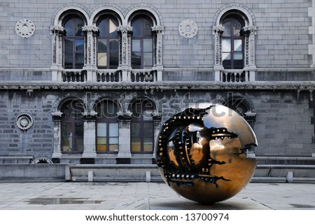 View of a modern sphere shaped sculpture in Trinity College, Dublin, Ireland - stock photo