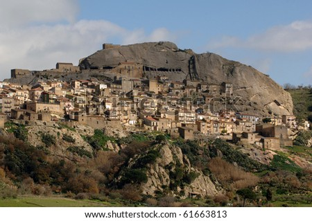 view of a old village dominated by a rocky castle in Sicily
