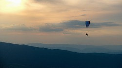 View of a parachutist from the Col de la Forclaz in Annecy