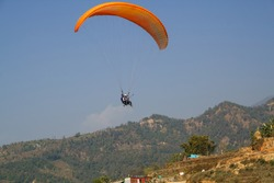 View of a paraglider above the mountain valley. Paragliding over Carpathian mountains.