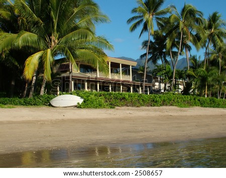View of a private home on a stunning beach - stock photo