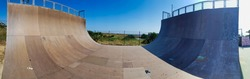 view of a ramp in the skatepark for skateboards and in line skates.skatepark background. half pipe ramp in the skatepark