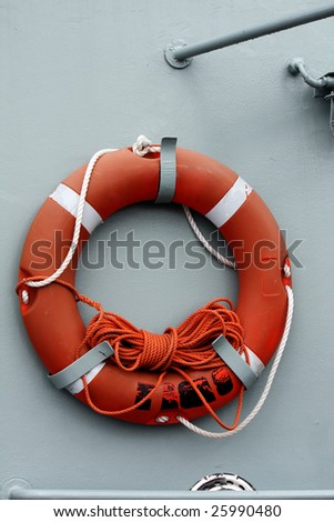 View of a red life saver buoy on a boat.