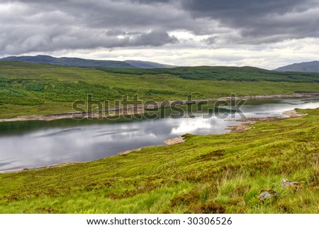 View of a river and mountains in Scottish Highland in HDR