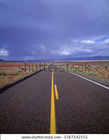 View of a road and rain clouds, Utah, USA