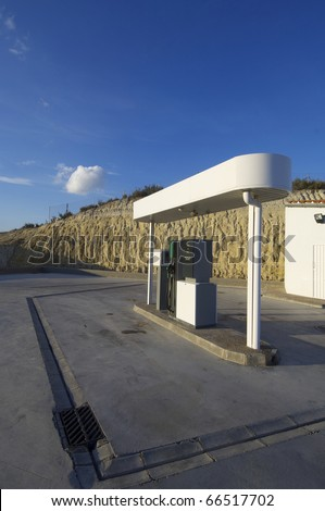 view of a small gas station white