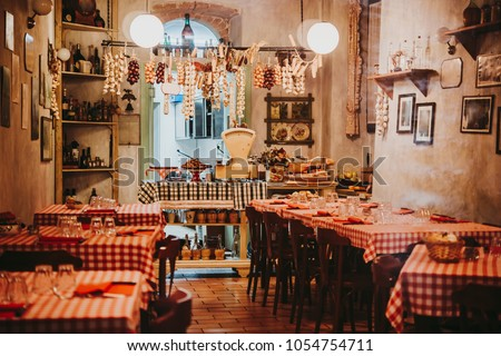 View of a small local restaurant or trattoria in Italy #1054754711
