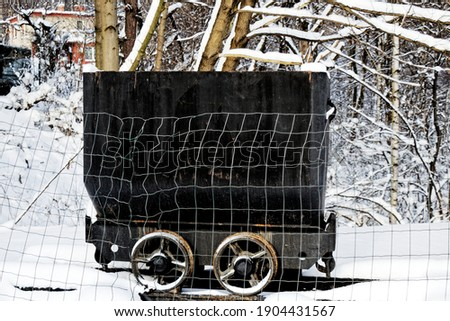 View of a small old black coal wagon in a winter landscape Zdjęcia stock ©