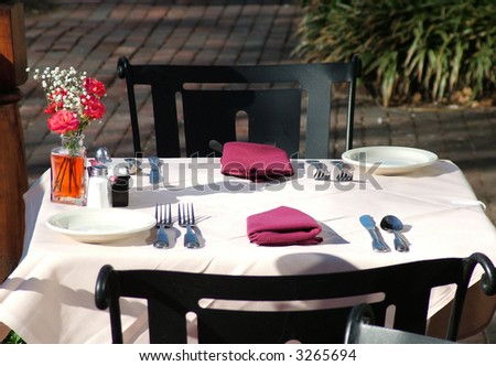 ... of a small outdoor table at an outdoor restaurant set up for lunch