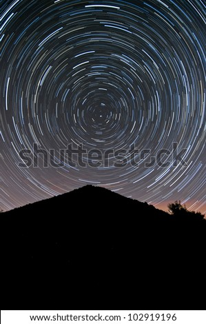View of a stratrails on the night sky.
