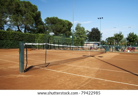 View of a tennis field with clay court