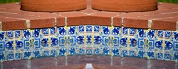 View of a Terracotta  water fountain with traditional Spanish Colonial hand painted blue and white mosaic Talavera tile.