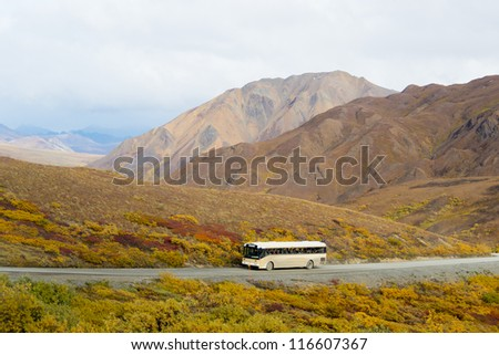 View of a tour bus taken from Polychrome Pass in Denali National Park, Alaska