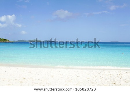 View of a tropical ocean from white sand beach