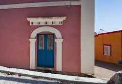 View of a typical colorful house of Linosa, colored with pink and white, Sicily. Italy