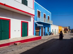 View of a typical colorful houses of Linosa, colored with white red and cyan,  Sicily. Italy