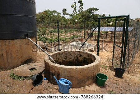 View of a water solar pumping system. The infrastructures are used to take out water from the ground and store it in a tank. The picture has been taken in a rural area of Guinea Bissau in Africa.