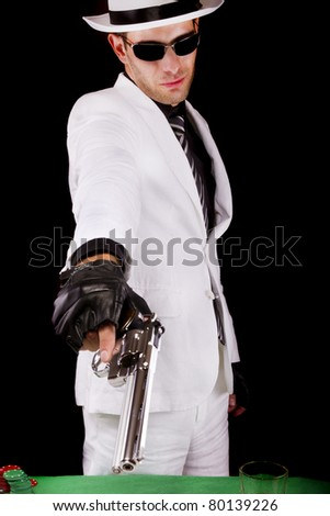 View of a white suit gangster man holding a gun.