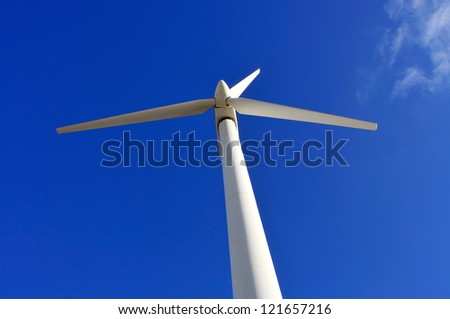 view of a wind turbine over the blue sky