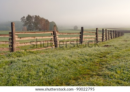 View of a wooden fence on a field.