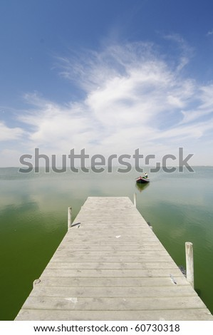 view of a wooden pier in Albufera lake, Valencia, Spain