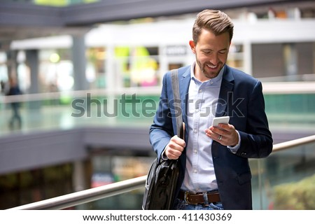 View of a Young attractive business man using smartphone #411430369