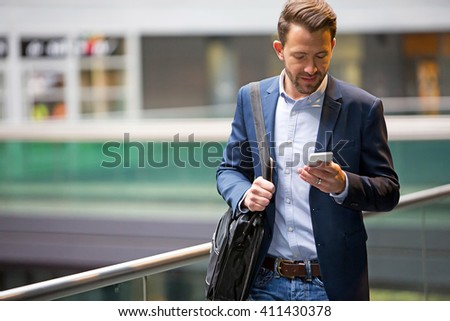 View of a Young attractive business man using smartphone #411430378