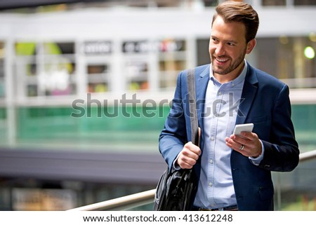 View of a Young attractive business man using smartphone #413612248