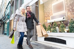 View of a Young attractive couple with shopping bags