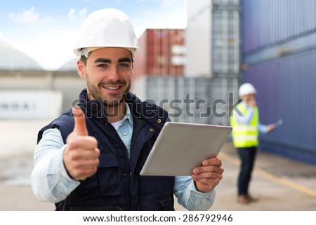 View of a Young Attractive docker using tablet at work