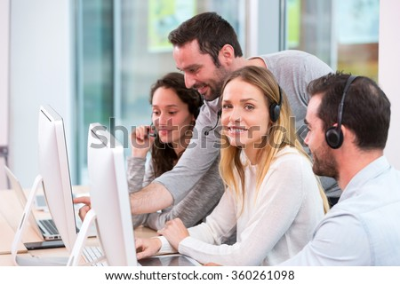 View of a Young attractive people learning their new job at call center  #360261098