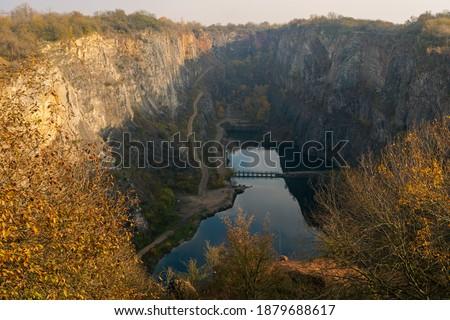 View of abandoned flooded limestone quarry called Velka Amerika (Big America), Czech Republic.. Autumnal landscape background Stok fotoğraf ©
