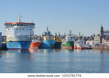 View of Aberdeen harbor in the day time, with offshore vessels in port. Offshore vessels at berth in Aberdeen harbor. #1355781776