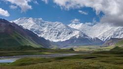 View of Achik Tash base camp of Lenin Peak nowadays Ibn Sina in the snow-capped Trans-Alay mountain range in southern Kyrgyzstan