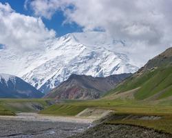 View of Achik Tash basecamp of Lenin Peak nowadays Ibn Sina peak in the snow-capped Trans-Alay or Trans-Alai mountain range in southern Kyrgyzstan