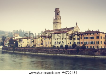 View of Adige River and riverside apartments. Verona Cathedral(Duomo Di Verona) and Castel San Pietro are also visible. `In 2000 Verona was listed as a World Heritage site by the UNESCO Committee.`