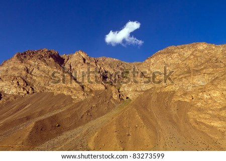 View of afghan mountains. Blue sky and cloud. Pamir