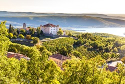 View Of Aiguines Village And Renaissance-style Chateau Overlooking Lac de Sainte Croix Lake-Alpes de Haute Provence,France