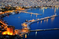View of Alanya harbor from Alanya peninsula. Turkish Riviera by night