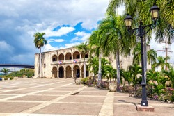 View of Alcazar de Colon Diego Columbus Residence from Spanish Square with blue sky. Famous colonial landmark in Dominican Republic