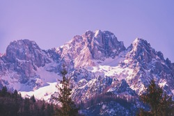 View of Alps in Kranjska Gora at sunrise. The tops of the mountains are covered with snow. Triglav national park. Slovenia, Europe