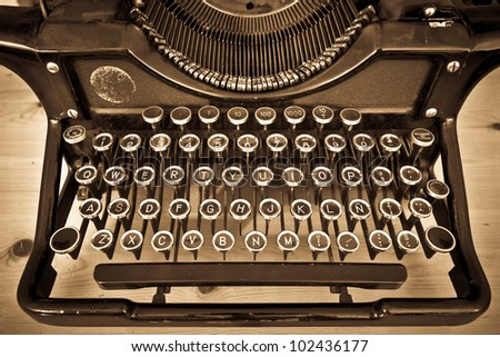 View of an antique manual Underwood typewriter on sepia