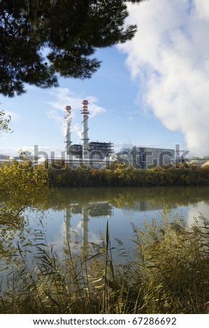 view of an  electricity power station on the banks of a river