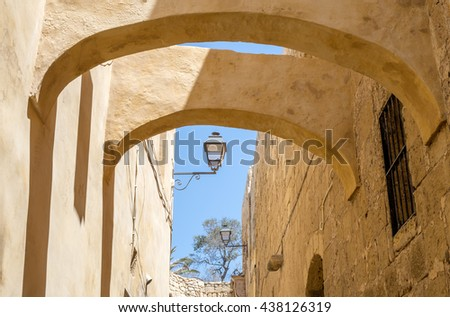 """View of an old lane of the ancient city and citadel of Victoria on the island """"Gozo"""" of Malta in South Europe"""