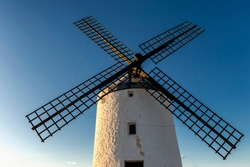 View of an old windmill located in the town of Consuegra (La Mancha, Spain), on the tourist route of the Cervantes mills (Don Quixote).