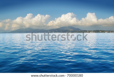 View of an open sea with a cloud on Corfu island, Greece