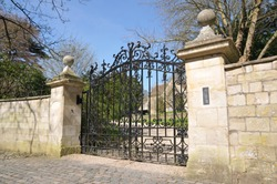 View of an Ornate Gated Entrance of an Old English Country House Driveway