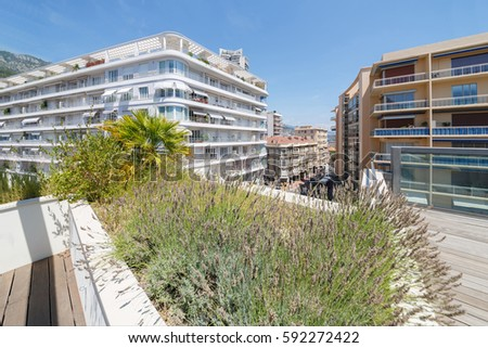 view of apartment building of one of densely populated districts of Monaco from roof #592272422